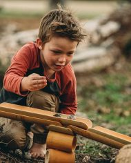boy-playing-bamboo-construct-roll-handmade-kids-toys-play