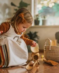 girl-playing-bamboo-construct-roll-handmade-kids-toys-play