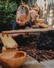 girl-playing-laughing-wooden-water-ways-eco-friendly-educational-toys