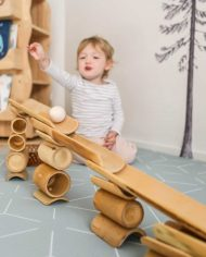 girl-smiling-bamboo-construct-roll-handmade-kids-toys-play