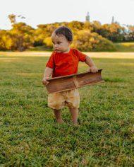 boy carry large bamboo set